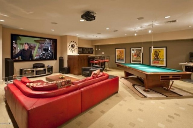 a TV watching space and a pool table are enough for a cool mnly party