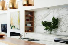 19 a marble kitchen island is completed with a wooden countertop and a couple of black leather stools