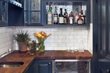 19 a small dark blue kitchen with a saturated wooden countertop looks chic