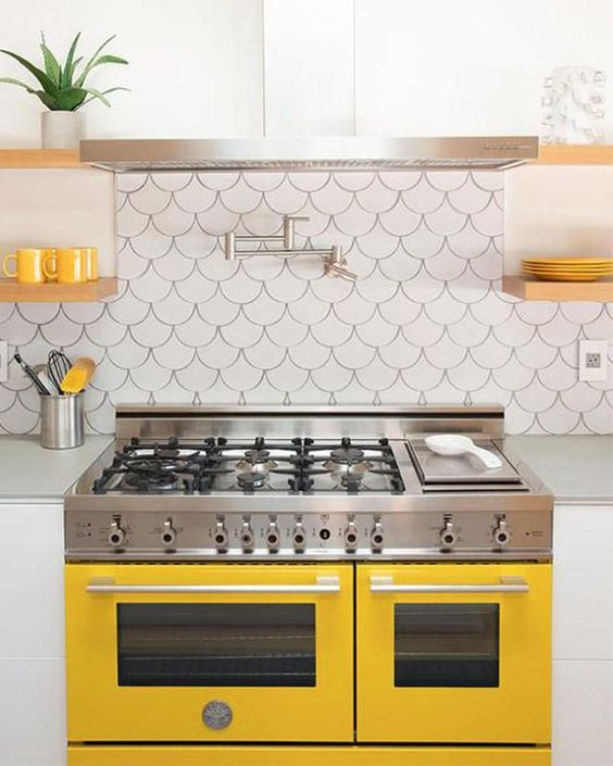 a sunny yellow cooker and matching touches for a chic modern kitchen