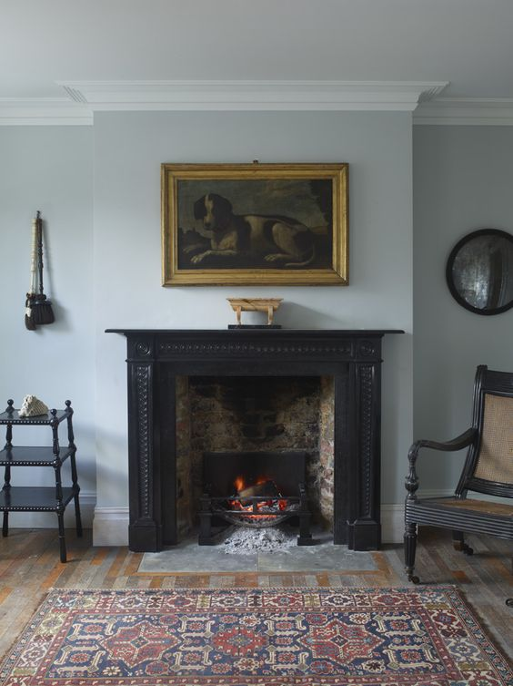 a vintage black fireplace, which is actually used for keeping the room warm and cozy