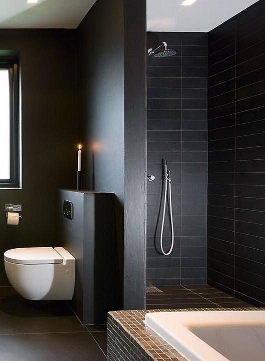 matte black shower tiles and matte grey and black surfaces for a moody masculine bathroom