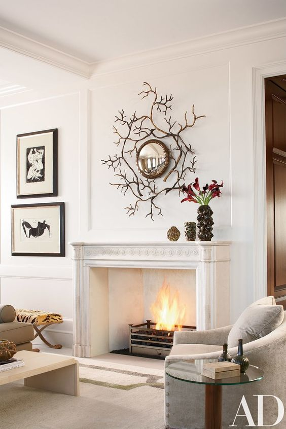 a vintage fireplace becomes a cover for a modern ethanol fireplace and looks cool