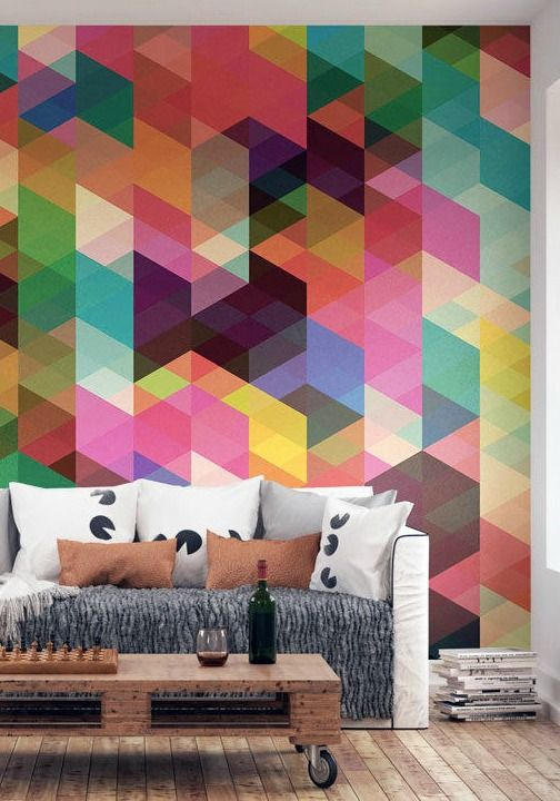 an industrial living room with a colorful geo statement wall
