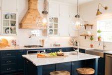 20 dark blue kitchen cabinets with marble countertops and suspended white cabinets