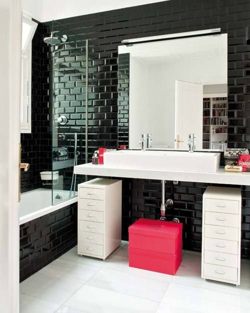 glossy black tiles with black grout for an eye-catchy monochrome space with pink accents