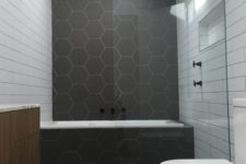 20 matte graphite grey hexagon tiles and white subway ones create an interesting and eye-catchy space