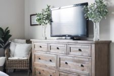 21 a farmhouse guest bedroom with a TV opposite the bed