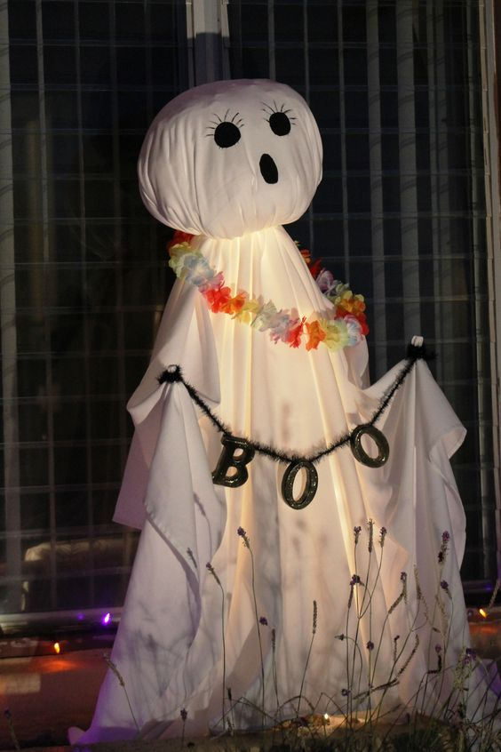 a ghost of a white sheet, with a letter banner and a bold fabric necklace