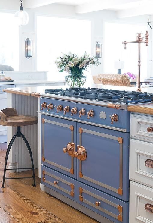 a retro French stove in blue with copper touches makes a gorgeous statement
