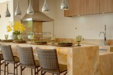 22 a gorgeous two-level kitchen island with a countertop for having meals made of marble