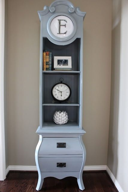 a grandfather's clock was repainted and repurposed into a shelf with drawers