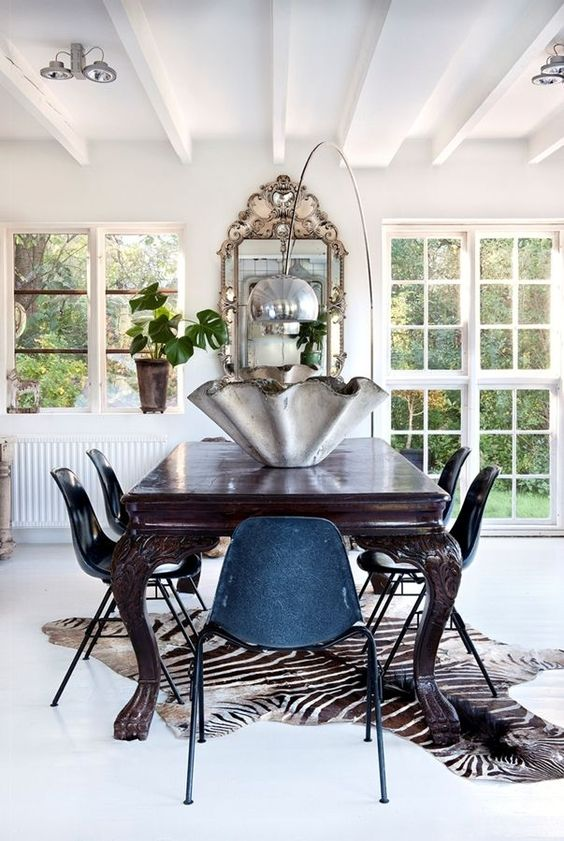 a large zebra print rug to spruce up a vintage dining space