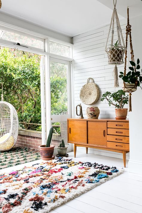 a boho space spruced up with a colorful textural rug