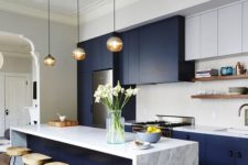 23 a kitchen island with a marble top acts as a cooking and eating space to save the space