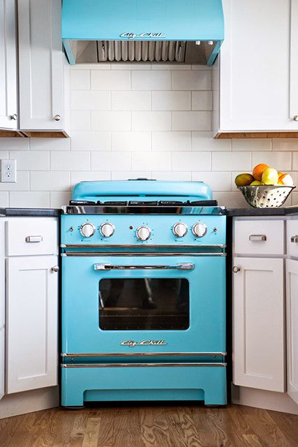 a retro bold blue stove and a matching hood to make a cool statement in your space