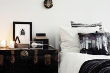 23 a vintage black trunk with copper detailing serves as a nightstand and a storage piece and it looks amazing