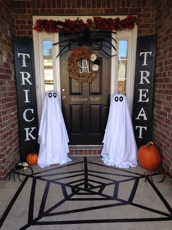 ghosts of white sheets are placed on both sides of the entrance