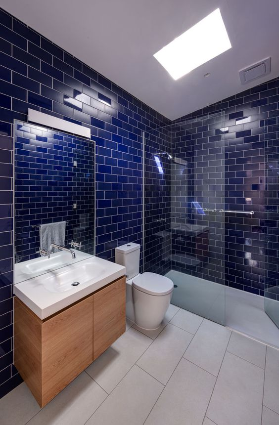 glossy cobalt blue tiles with white grout are a great choice for a modern bathroom with a color statement