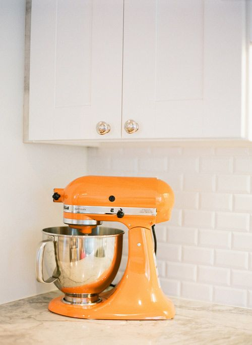 a kitchen aid mixer in bold orange to raise your mood while cooking