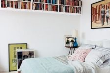 24 bookshelves under the ceiling won't take any floor space but will provide much reading
