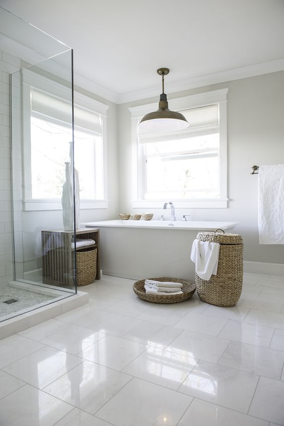 glossy large scale tiles on the floor make the peaceful bathroom more eye catchy