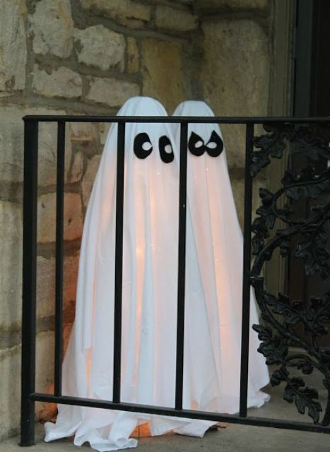 make some ghosts of white sheets and add eyes of black fabric, then lit them up from the inside