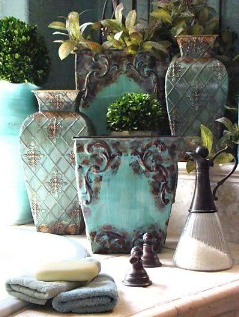 shabby aqua pots with a touch of rust look amazing in a Mediterranean interior