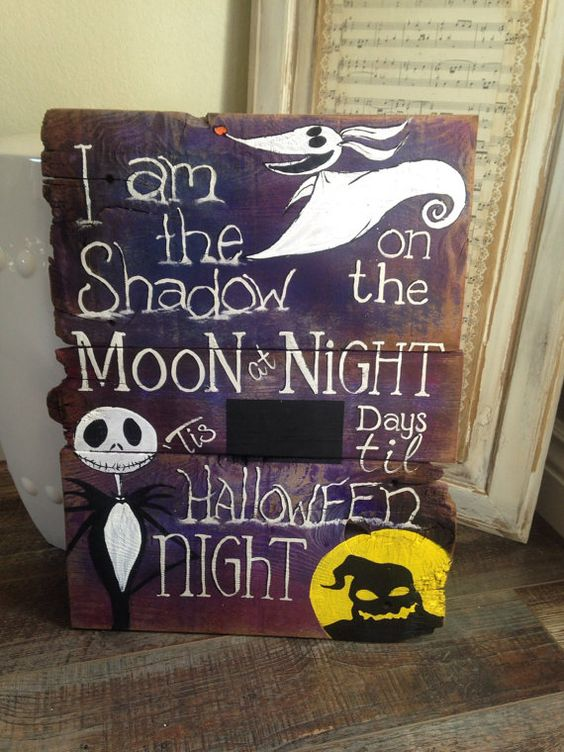 a Nightmare Before Christmas countdown sign in purple, black, white and yellow