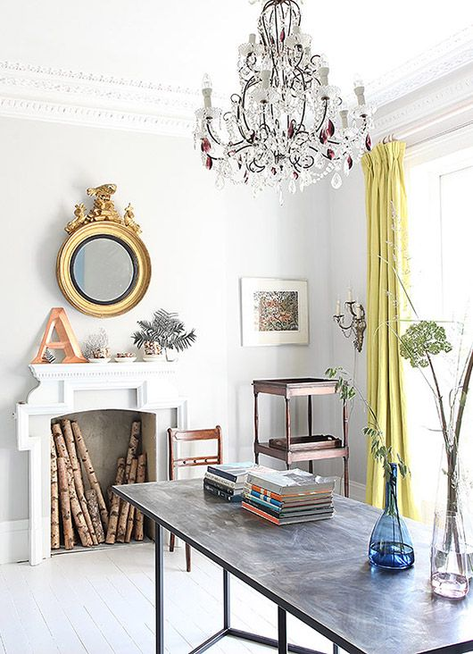 a neutral space with glam touches and lemon yellow curtains for a chic look