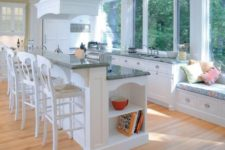 25 a two-level kitchen island with two level for cooking and eating perfectly fits a traditional kitchen