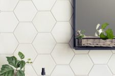 25 matte white tiles with white grout for a chic and timeless bathroom