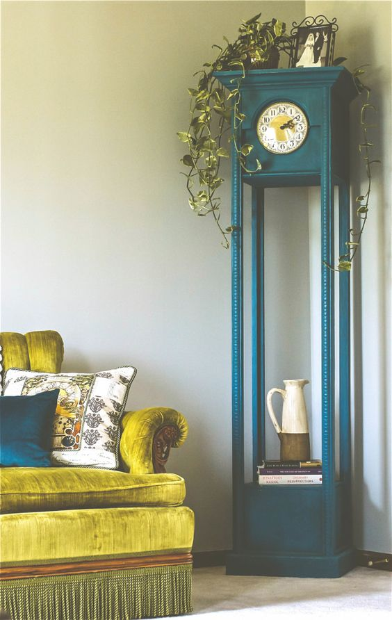 paint the clock in a bold shade, for example, teal, and use the lower part as a shelf