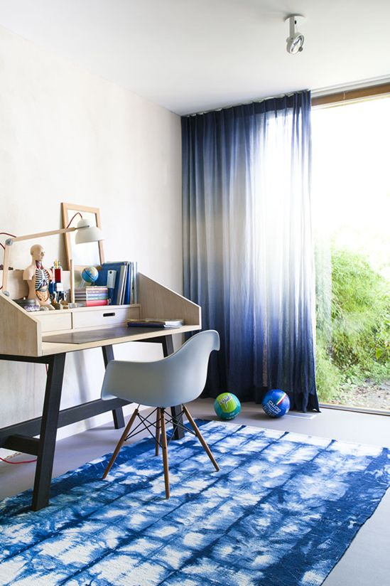 shibori curtains and a rug for a bold kid's room