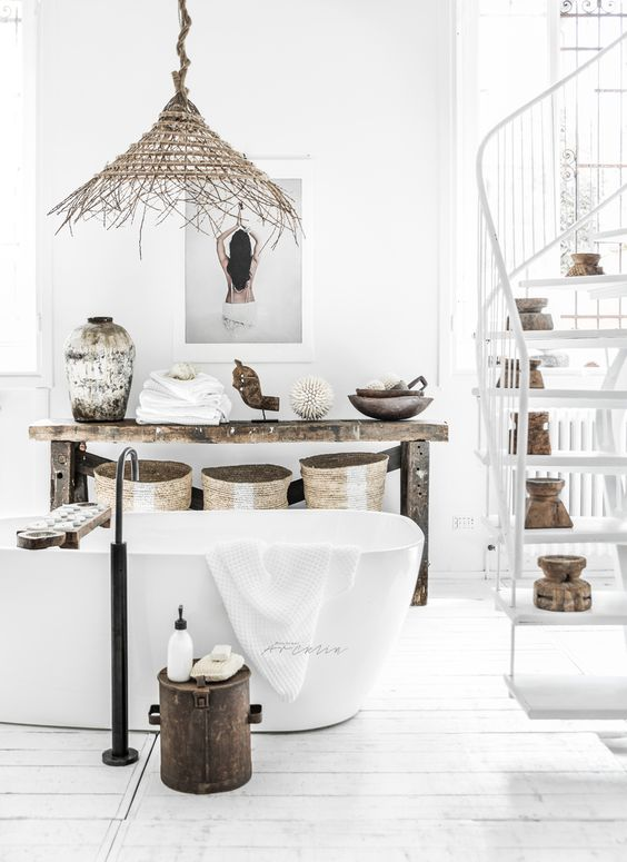 wicket baskets, a wicker lamp, shabby vases and natural wood touches add to the white space