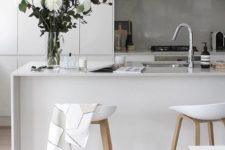 26 a kitchen island doubles as a kitchen countertop for eating