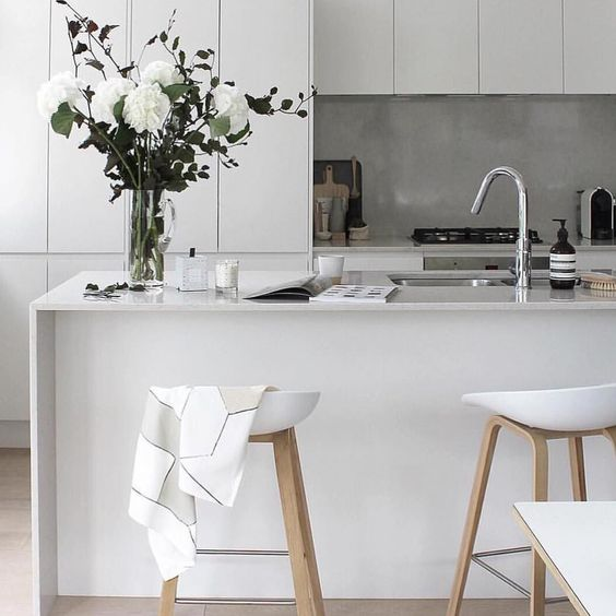 a kitchen island doubles as a kitchen countertop for eating