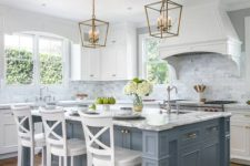 26 a vintage kitchen is given a coastal touch with a pale blue kitchen island