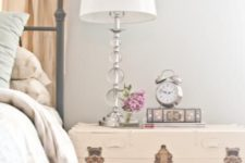 26 a whitewashed wooden trunk as a refined bedside table for a feminine bedroom