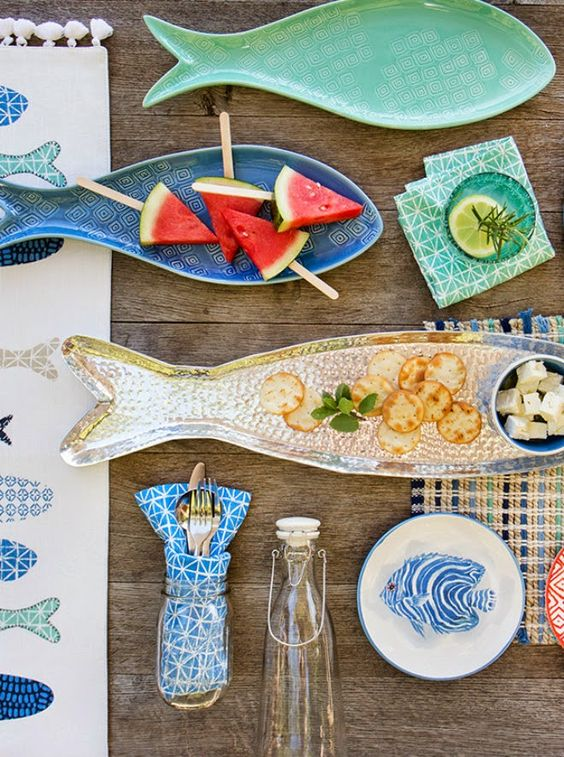 fish shaped and painted dishes and plates are perfect for a Mediterranean dining space