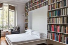 26 make a guest bedroom in the library creating bookshelf walls with a murphy bed