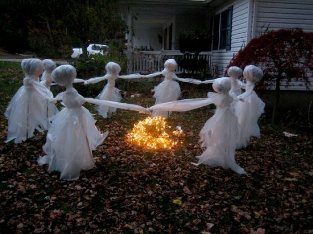 scary children ghosts dancing around the fire are made of white tulle and wire