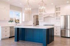 27 a white vintage kitchen with a cobalt blue kitchen island and a white countertop