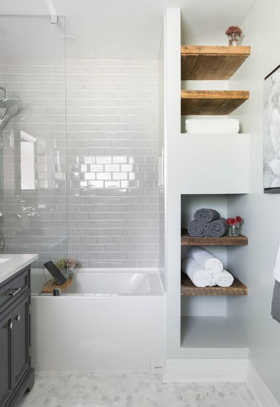 glossy white subway tiles with white grout make the bathtub zone look more interesting and glossy