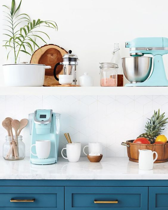 a tiffany blue coffee machine and mixer for a chic blue and brass kitchen