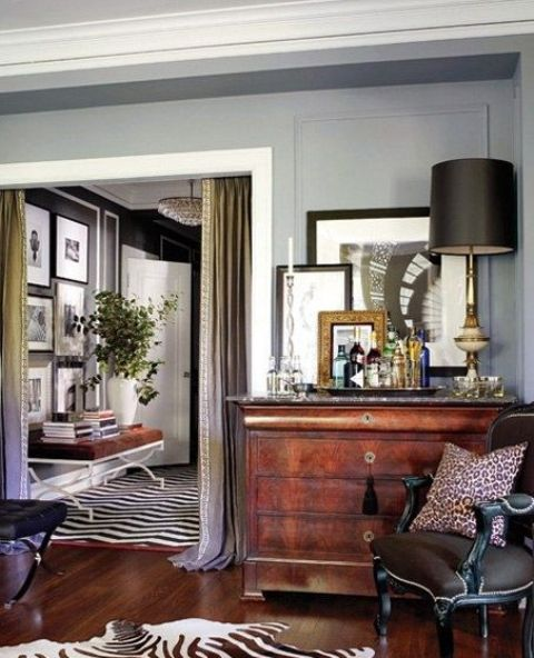 a zebra print rug and a cheetah print pillow for accentuating a refined space