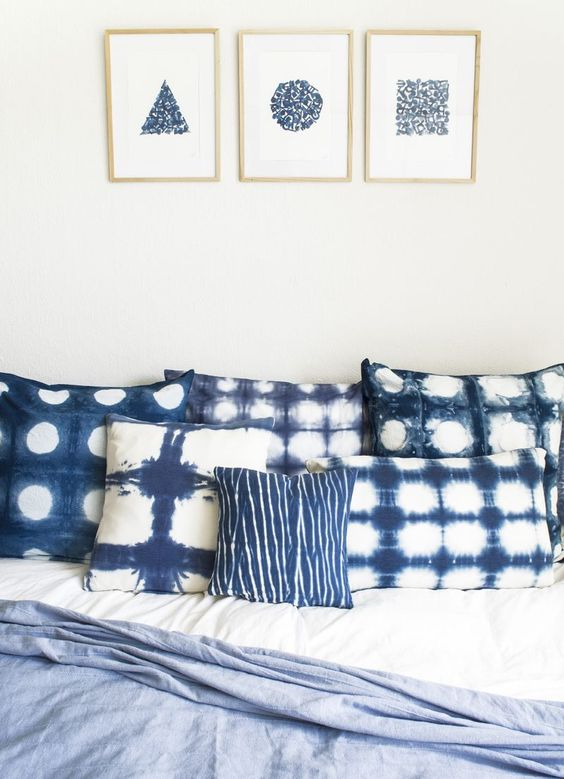shibori dyed pillows and matching wall arts on the wall will make your bedroom heavenly