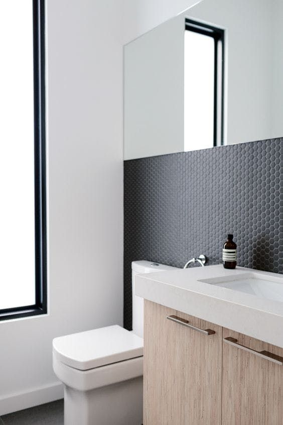 tiny matte black hex tiles to make a minimalist bathroom eye-catching