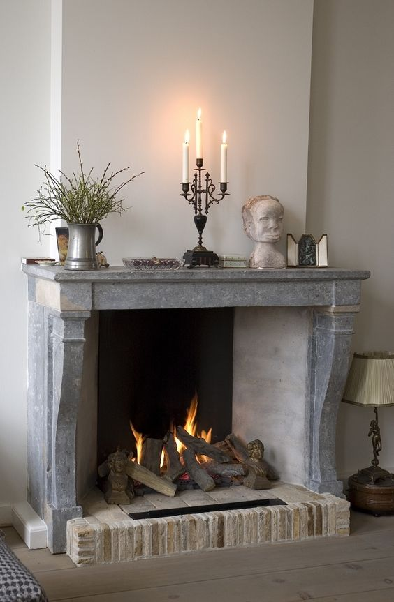 use your antique stone and brick fireplace as a real one if it allows, why not add a cozy feel