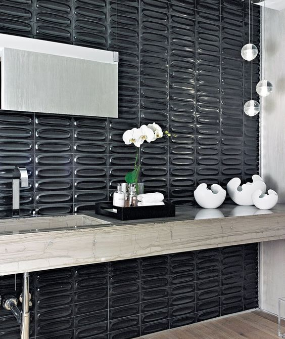textural glossy black tiles make the bathroom refined, chic and eye-catchy